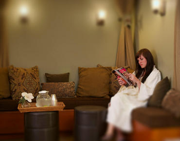 woman reading in spa